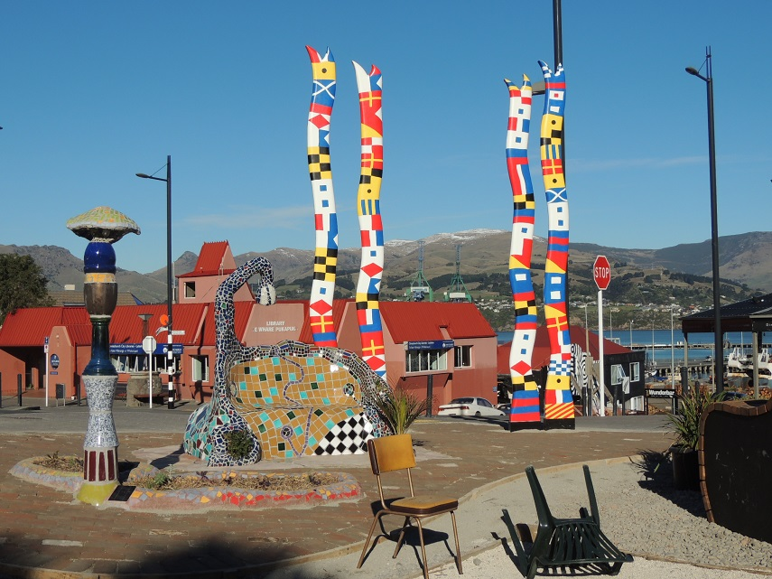 A mosaic seat and tall colourful pillars